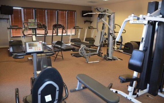 workout room with machines